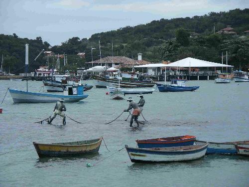 fishermen pulling on a net