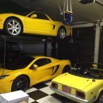 Three Cars in a Garage. All cars are yellow