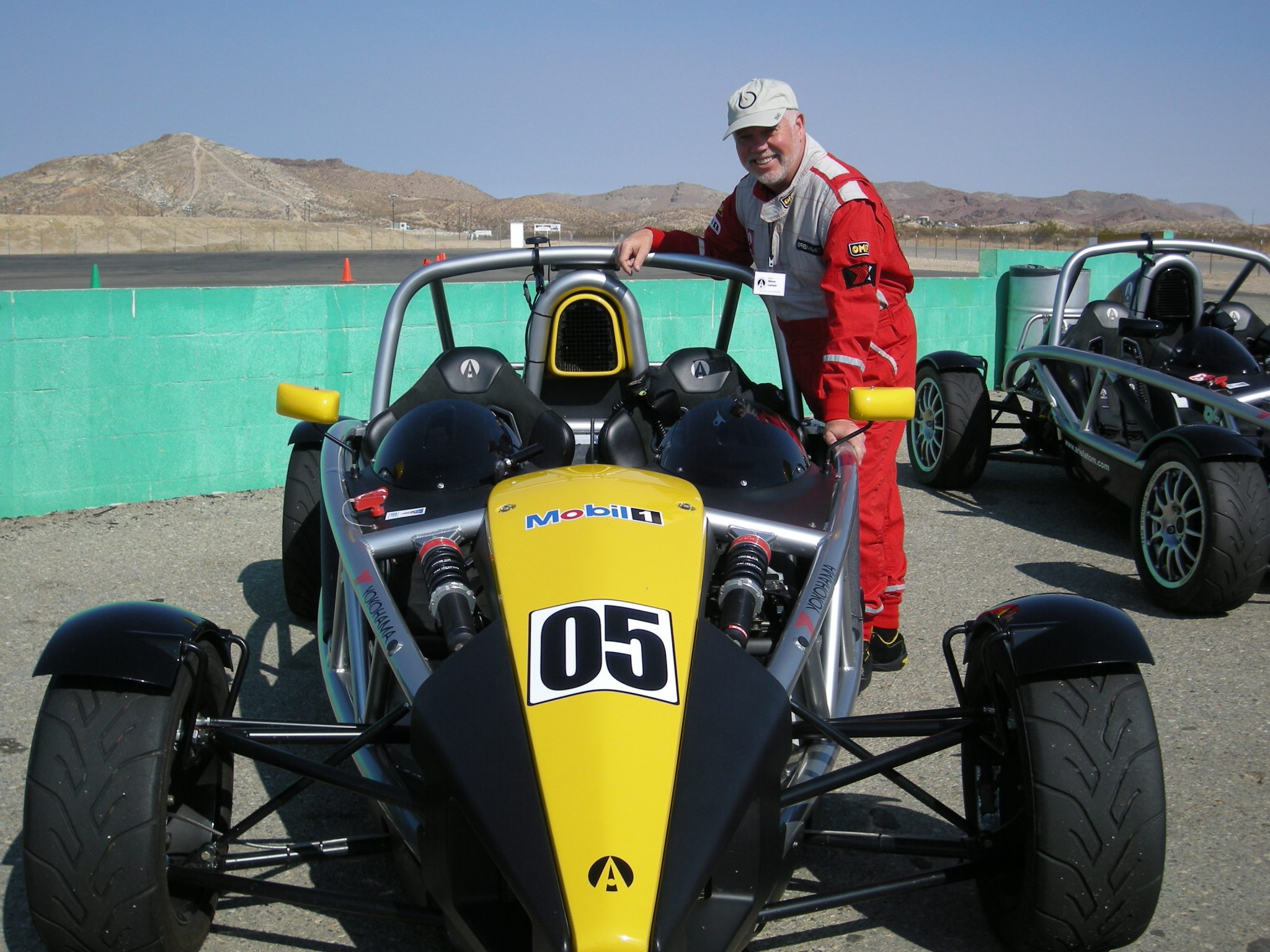 man standing by race car