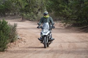 Man riding a motorcycle on a dirt road