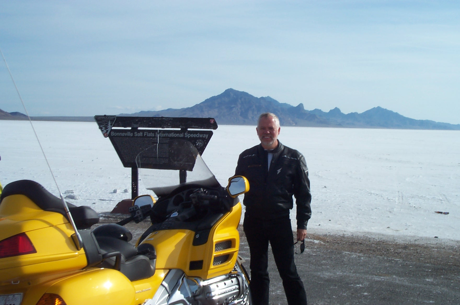 Man with yellow motorcycle