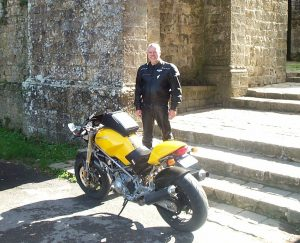 Man and yellow Ducati motorcycle