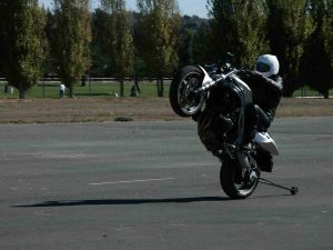Rider doing a wheelie on a motorcycle