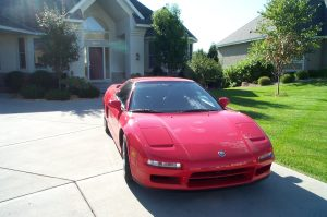 a 1997 Acura NSX, red