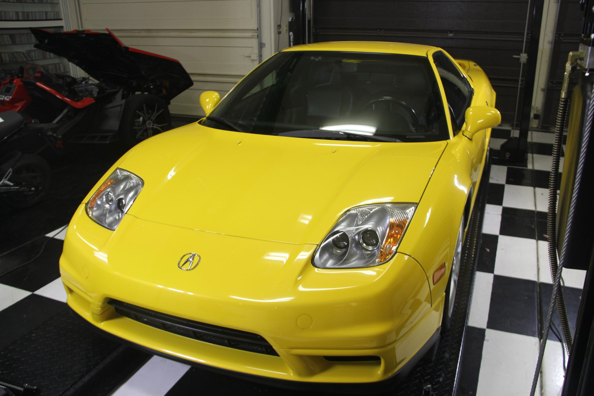 Acura NSX in the garage - yellow