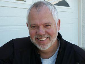 Steve Larsen, smiling