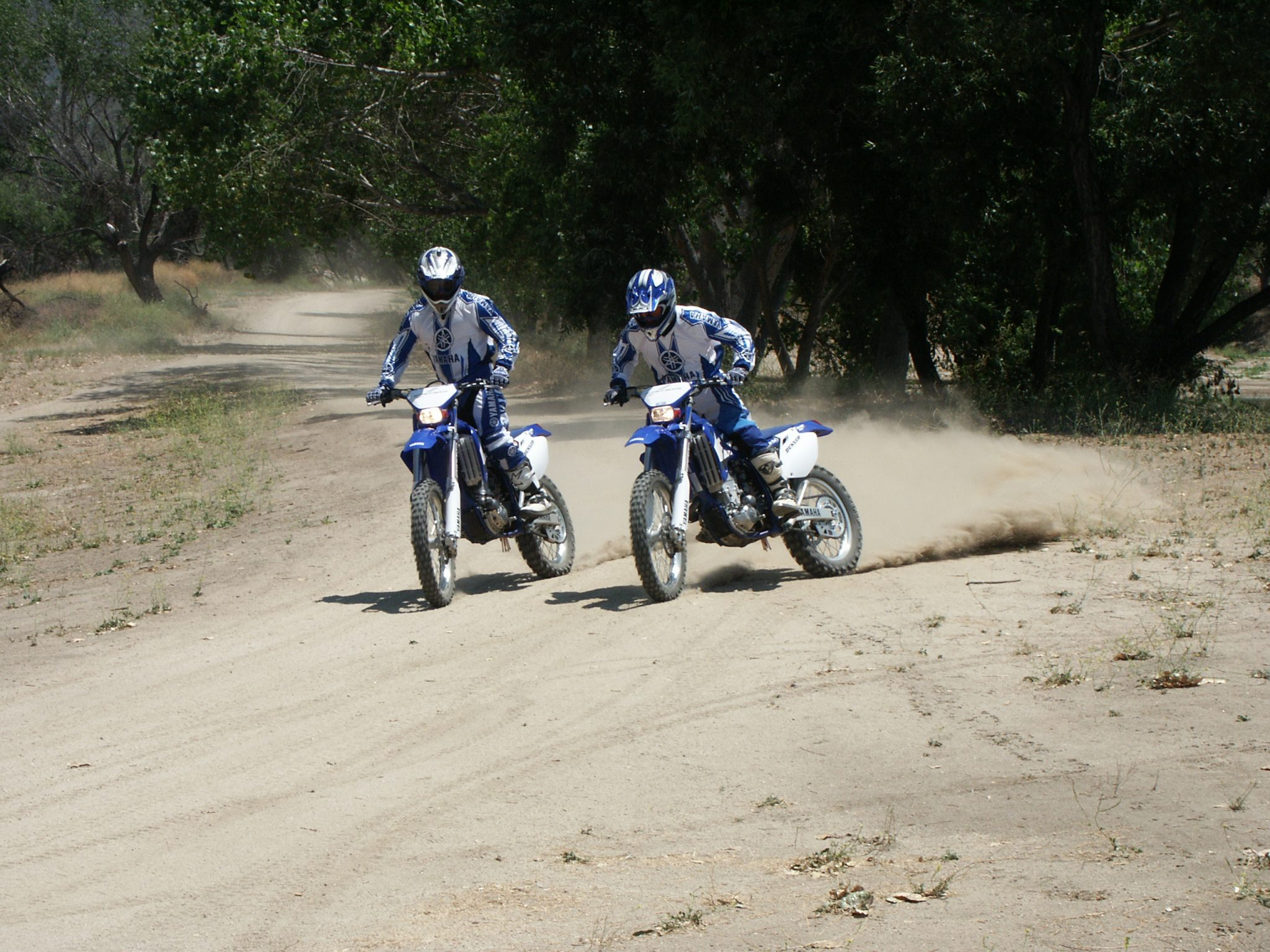 two men riding motorcycles
