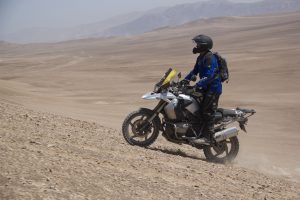 Man riding a motorcycle in the desert