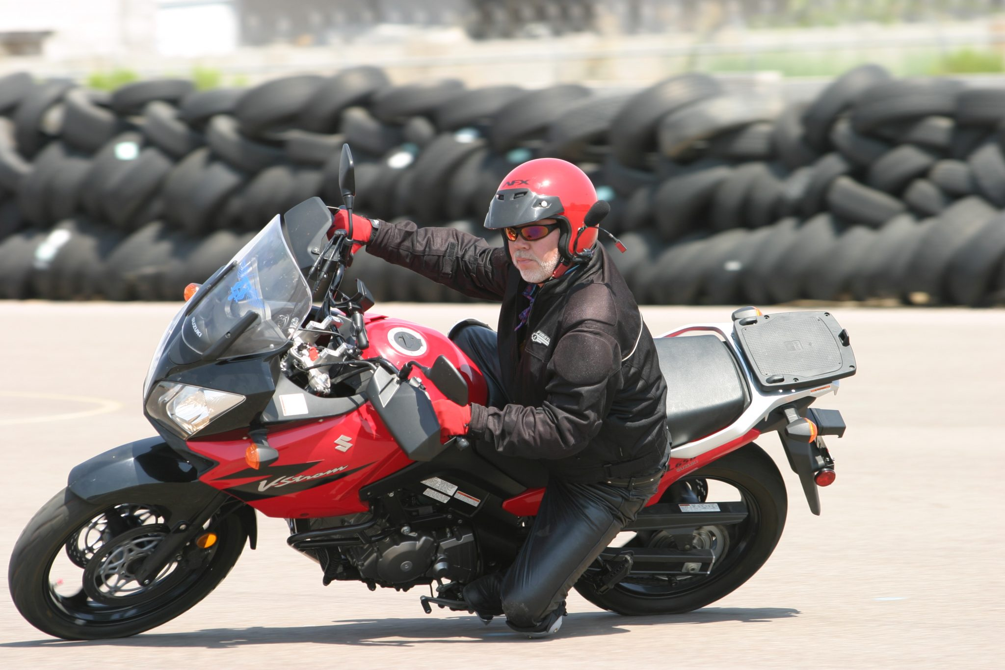 man riding motorcycle on a track