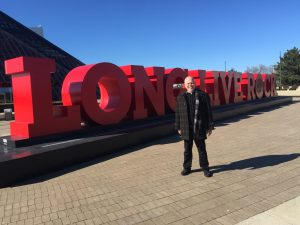 Steve standing in front of Long Live Rock sign.