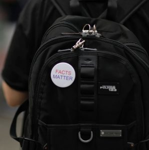 button on backpack: Facts Matter